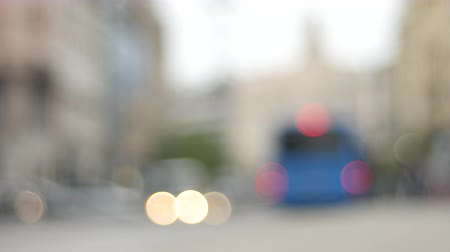 cloud scape : Blurry bokeh scene in the city during the daytime with cars passing by. Stock Footage
