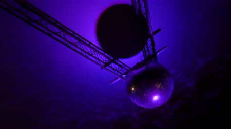 mirror glass : Footage of a spinning mirrored sphere disco with reflections by colorful lights on the roof. Stock Footage