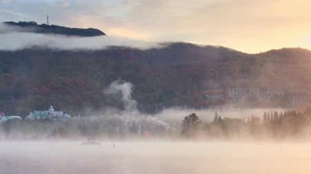 Heavy fog over lake with mountain and foliage in Mont-Tremblant near Montreal in Canada Dostupné videozáznamy