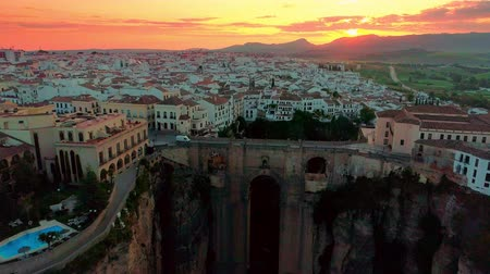malaga : Ronda aerial view with historical bridge and city skyline at sunrise in Spain.