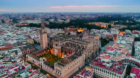 espana : Dusk aerial view of Seville Cathedral and city skyline in Spain.