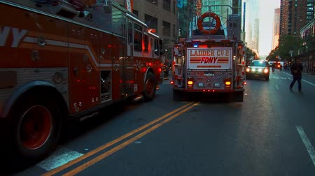 avenida : NEW YORK CITY, USA - OCT 30, 2018: Fire truck and police car ambulance at 42nd street in response to an emergency incident in Midtown Manhattan.