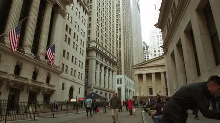 NEW YORK CITY, USA - OCT 30, 2018: Walk forward in Wall Street with skyscrapers as the famous financial district in downtown Manhattan.