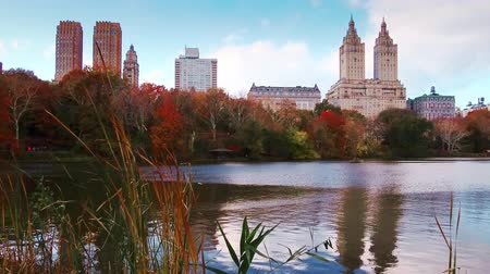 New York City Central Park in Autumn with skyscrapers apartment and lake