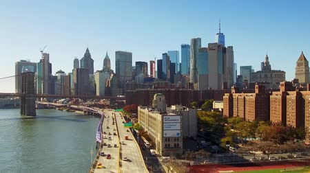 NEW YORK CITY, USA - OCT 30, 2018: Timelapse view from above of downtown Manhattan with Brooklyn Bridge and traffic.