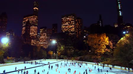 skate : Ice Rink in Central Park slow motion in winter with people skate in Midtown New York City