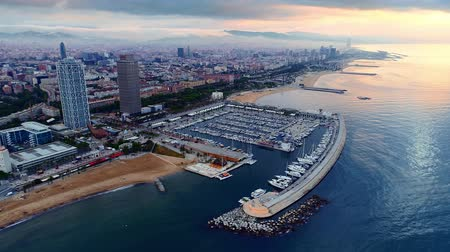 バルセロナ : Aerial view of yacht and coast view with office buildings and Barcelona skyline in Spain. 動画素材