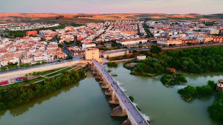 Андалусия : Drone view above the Roman Bridge in C?rdoba at sunset in Spain