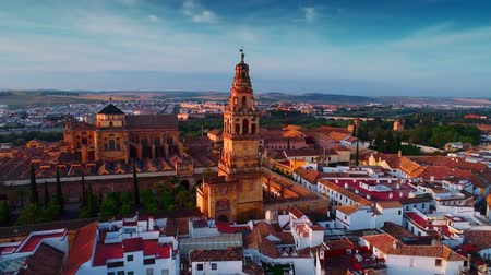 Aerial drone view of the bell tower of Great Mosque of Cordoba or The Mosque Cathedral of C?rdoba at sunset in Spain
