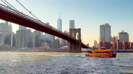 water taxi : New York City - Sept 28, 2018: Boat drive below Brooklyn Bridge. New York City is the most populous city in the United States.