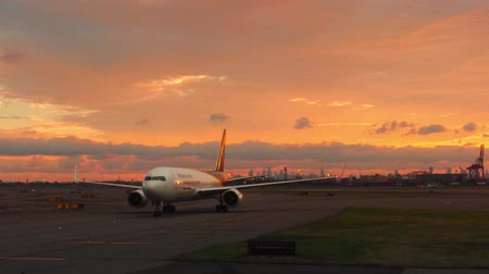 new jersey : Newark, USA - June 28, 2018: Newark Liberty International Airport EWR with airplanes at sunrise. EWR was the fifteenth busiest airport in the United States.
