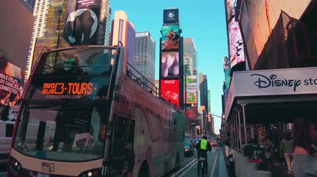 midtown manhattan : New York City - Sept 28, 2018: Times square with crowded traffic billboard and people. New York City is the most populous city in the United States. Stock Footage