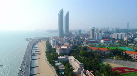 gezi : Xiamen, China - Mar 28, 2018: City aerial view with Shimao tween tower. Xiamen was ranked as Chinas 2nd-most suitable city for living due to its low pollution. Stok Video