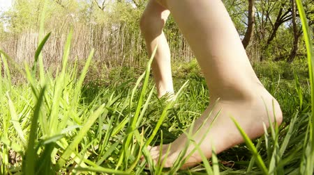 menta : bare foot little girl dancing on the green grass