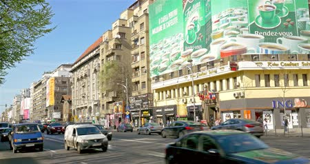 traffic bucharest : BUCHAREST, ROMANIA - APRIL 05, 2015: Rush Hour Traffic In University Square Downtown Of Bucharest City. Stock Footage