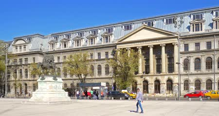 traffic bucharest : BUCHAREST, ROMANIA - APRIL 13, 2016: The University Of Bucharest (Universitatea Din Bucuresti) In Romania Is An University Founded In 1864 And Is Located In Downtown Historical Center Of The City.