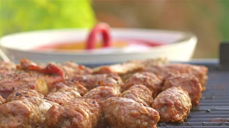 fried stake : Traditional Romanian Barbecue With Pork Meat Rolls (Mici Or Mititei) And Stakes