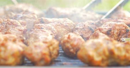 fried stake : Preparing Traditional Romanian Barbecue With Pork Meat Rolls (Mici Or Mititei) And Stakes