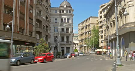 traffic bucharest : BUCHAREST, ROMANIA - JUNE 15, 2016: Rush Hour On Victory Avenue (Calea Victoriei) Downtown Of Bucharest City. Stock Footage