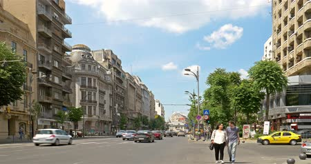traffic bucharest : BUCHAREST, ROMANIA - JUNE 15, 2016: Rush Hour On Gheorghe Magheru Boulevard Of Bucharest, One Of The Most Expensive Commercial Streets In The World.