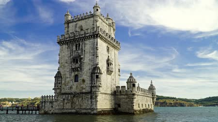 LISBON, PORTUGAL - AUGUST 11, 2017: Built in 1519 Belem Tower (Tower of Saint Vincent) is a fortified tower in Lisbon City and a UNESCO World Heritage Site. Стоковые видеозаписи