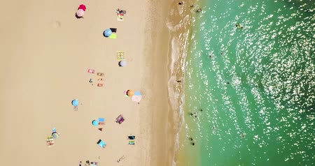 bakış : Aerial Footage From Flying Drone Of People Crowd Relaxing On Beach In Portugal