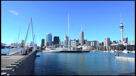 nzl : AUCKLAND, NZ - JUNE 01 2014:Auckland downtown skyline.Auckland has been rated one of the worlds top 10 cities to visit by travel bible Lonely Planet.