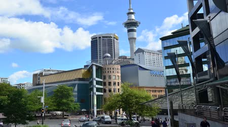 capital cities : Auckland cityscape street scene with the sky tower in the city CBD central business district in Auckland New Zealand.