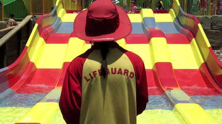 lifesavers : GOLD COAST, AUS - OCT 30 2014:Australian Lifeguard in WetnWild Gold Coast Australia.They are world-renown for their high levels of skill and knowledge in accident prevention and rescue response