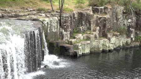 waterfall cascading into pool : Charlies Rock waterfall in Kerikeri Northland New Zealand