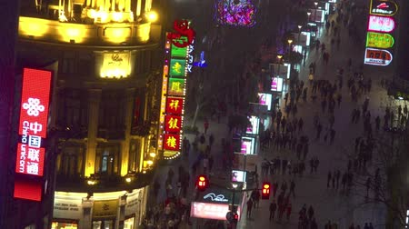 nanjing road : SHANGHAI, CN - MAR 17 2015:Visitors at Nanjing Road. It is the main shopping street of Shanghai, China, and is one of the worlds busiest shopping streets.