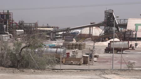 potash : EIN BOKEK, ISR - APR 30 2015:Dead Sea Works plant.Its the worlds 4th largest producer of potash products plant blamed by conservationists for polluting the Dead Sea environment and its evaporation Stock Footage