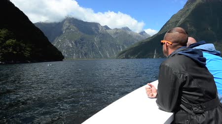 nzl : MILFORD SOUND,NZ - JAN 14:Visitors sail in Milford Sound on Jan 14 2014.It has been judged the worlds top travel destination in the 2008 Travelers Choice Destinations Awards by TripAdvisor.
