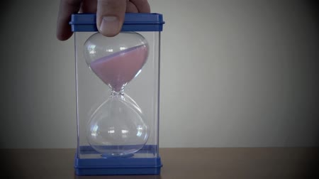 clock hands : person timing time with hourglass sand timer watch clock Stock Footage