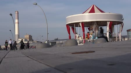 kolotoč : TEL AVIV, IS - MAR 29 2015:The First Hebrew Carousel in Old Tel Aviv Port Area, Israel.Its a famous commercial and entertainment district in northwest Tel Aviv, Israel along the Mediterranean Sea. Dostupné videozáznamy