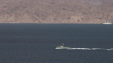 aqaba : EILAT, ISR - APRIL 15 2015:Israeli Navy boat patrolling in the Gulf of Eilat, Israel.Israel Defense Forces, operating primarily in the Mediterranean Sea theater as well as the Red Sea theater. Stock Footage