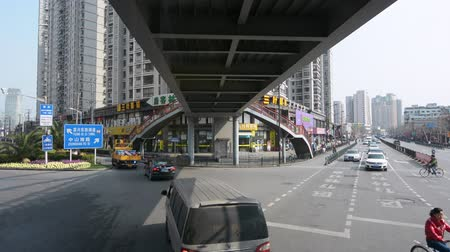 nanpu : SHANGHAI, CN - MAR 15 2015:Traffic against Shanghai cityscape.Shanghai is the largest Chinese city by population and the largest city proper by population in the world with over 2 million vehicles.SHANGHAI - MAR 16 2015:Passengers get on a ferry boat in S