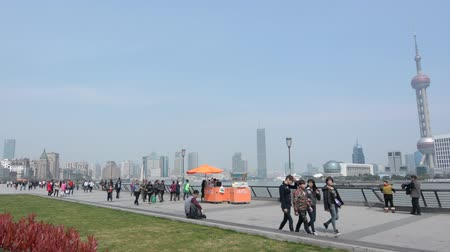 yangtze : SHANGHAI, CN - MAR 17 2015:Visitors on Shanghai - The Bund or Waitan.Shanghai Bund has dozens of historical buildings and It is one of the most famous tourist destinations in Shanghai.