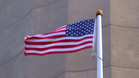 hűség : The national flag of United State of America fly in slow motion. Sign and symbols background.