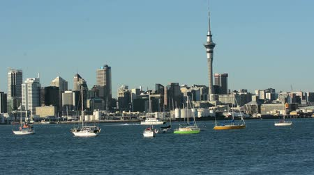nzl : AUCKLAND, NZ - MAY 27 2014:Ferry sail under Auckland downtown skyline.Auckland has been rated one of the worlds top 10 cities to visit by travel bible Lonely Planet. Stock Footage