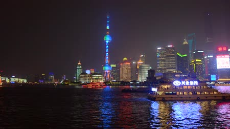 yangtze : SHANGHAI, CN - MAR 15 2015:Pudong New Area skyline in Shanghai, China at night.Its home to the Lujiazui Finance and Trade Zone, Shanghai Stock Exchange and many of Shanghais best-known buildings.