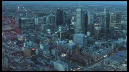 urban skyline : MELBOURNE - APR 14, 2014:Aerial view of Melbourne Victoria, Australia.Melbourne have population and employment growth with international investment in the citys industries and property market. Stock Footage