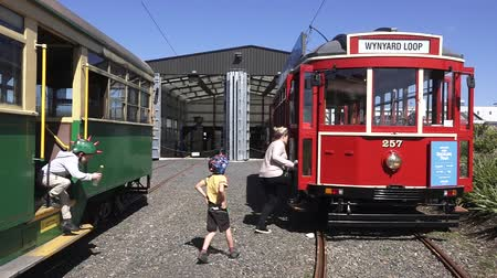 docklands : Family visit in Auckland Dockline Wynyard Quarter Tram.The vintage tram currently runs on a newly built 1.5 km 0.93 mi circuit in Wynyard Quarter in Auckland, New Zealand. Stock Footage