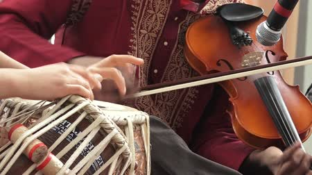 baya : Indian people play music with musical instrument Violin and Tabla