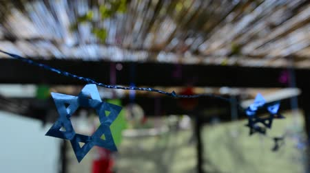 sukkah : Decorations inside a Jewish family Sukkah for the Jewish festival of Sukkot. A Sukkah is a temporary structure where meals are taken for the week.