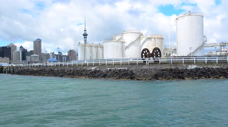 nzl : Bulk Storage Terminals against Auckland skyline New Zealand.Its New Zealand custom bonded site, licensed as a transitional facility for containers imported into New Zealand. Stock Footage