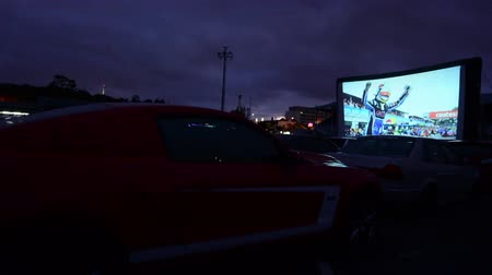 outside view : Cars in Drive-in theater.Today there is only 400 drive-ins in the United States and 100 exist around the world mainly in Canada and Australia and it becoming popular in China. Stock Footage