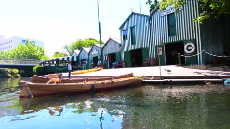 nzl : Punting and Kayaks boat shed on the Avon river Christchurch.It is an iconic tourist attraction of Christchurch, New Zealand. Stock Footage