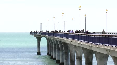 nzl : Visitors on New Brighton Pier in Christchurch. The pier is one of Christchurch main tourist attractions, spanning 300 meters long, it is the longest pier in the Australasia