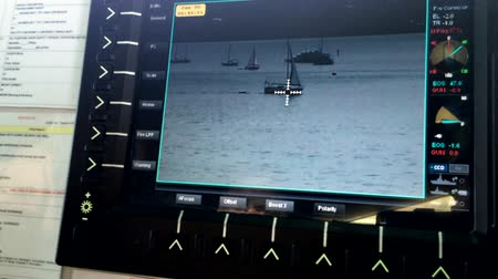 operational system : AUCKLAND - JAN 30 2016:Surveillance camera monitor on patrol boat. Its commonly engaged in border protection roles as: anti-smuggling, anti-piracy, fisheries patrols, and immigration law enforcement. Stock Footage